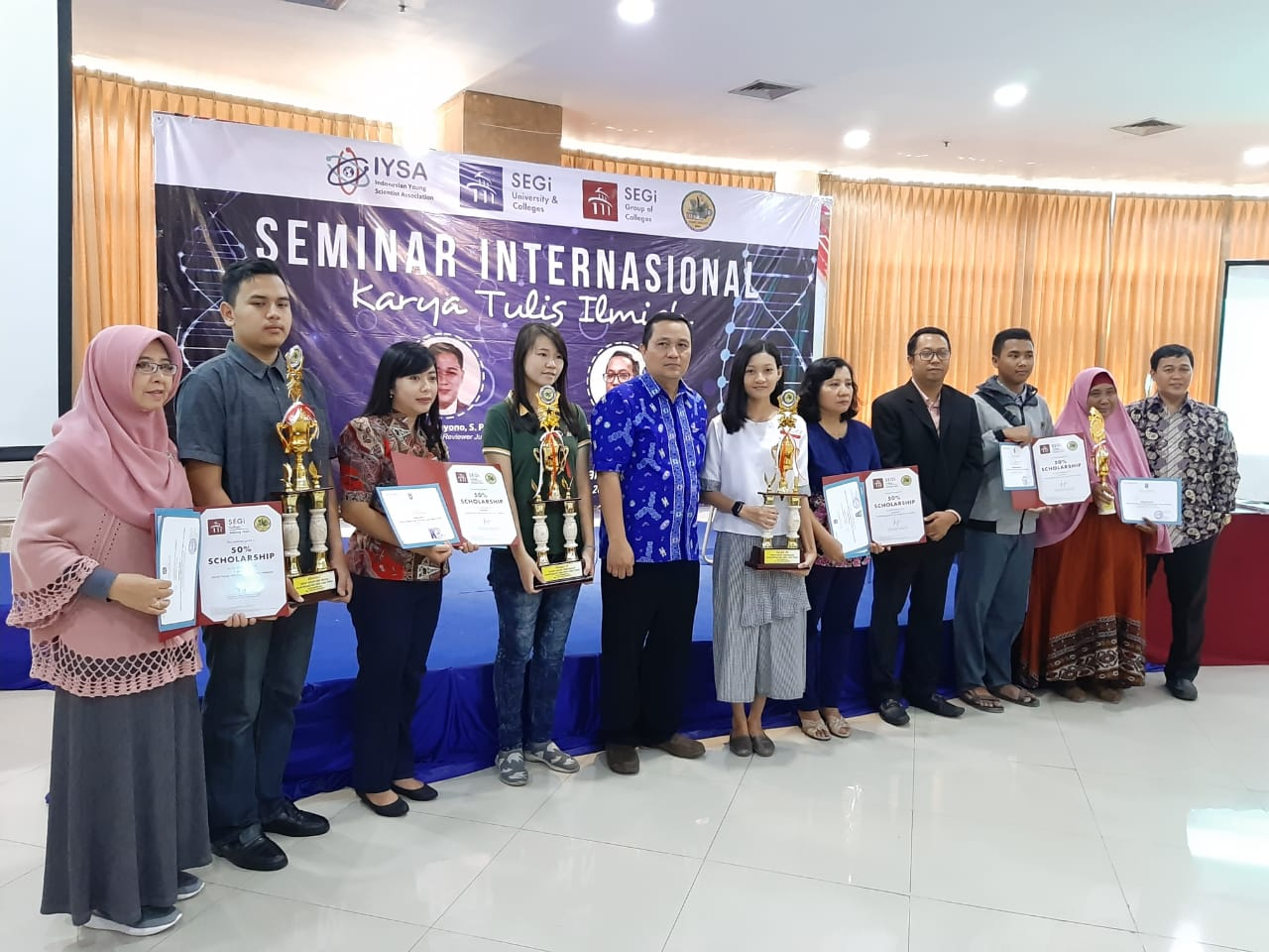 Seminar Internasional Karya Tulis Ilmiah Bersama SEGi University, MGMP Biologi Jawa Timur dan Pendidikan.id